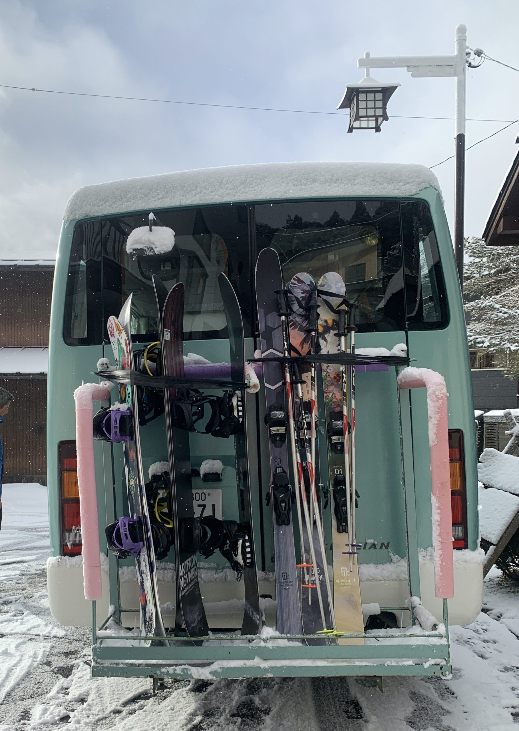 Skis and Snowboards on a bus